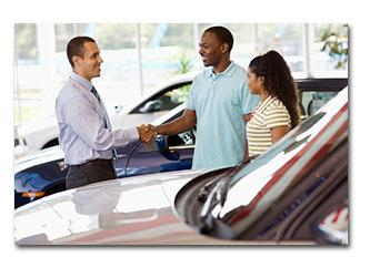 Auto dealer selling a car to a couple