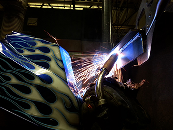 welder laying a bead of mig weld